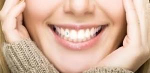 dentes piercing